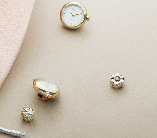 Rocking Charm Watch with Gold Plated Case, Champagne Dial and White Stones - RCW3300CZ